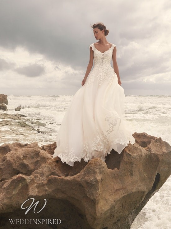 A Sottero & Midgley Spring 2021 ivory lace and tulle A-line wedding dress with cap sleeves and a v neck