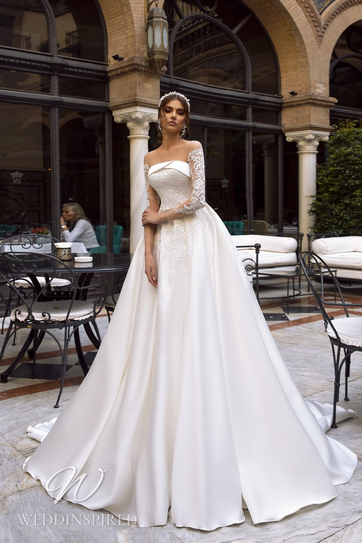A Maks Mariano strapless satin princess wedding dress