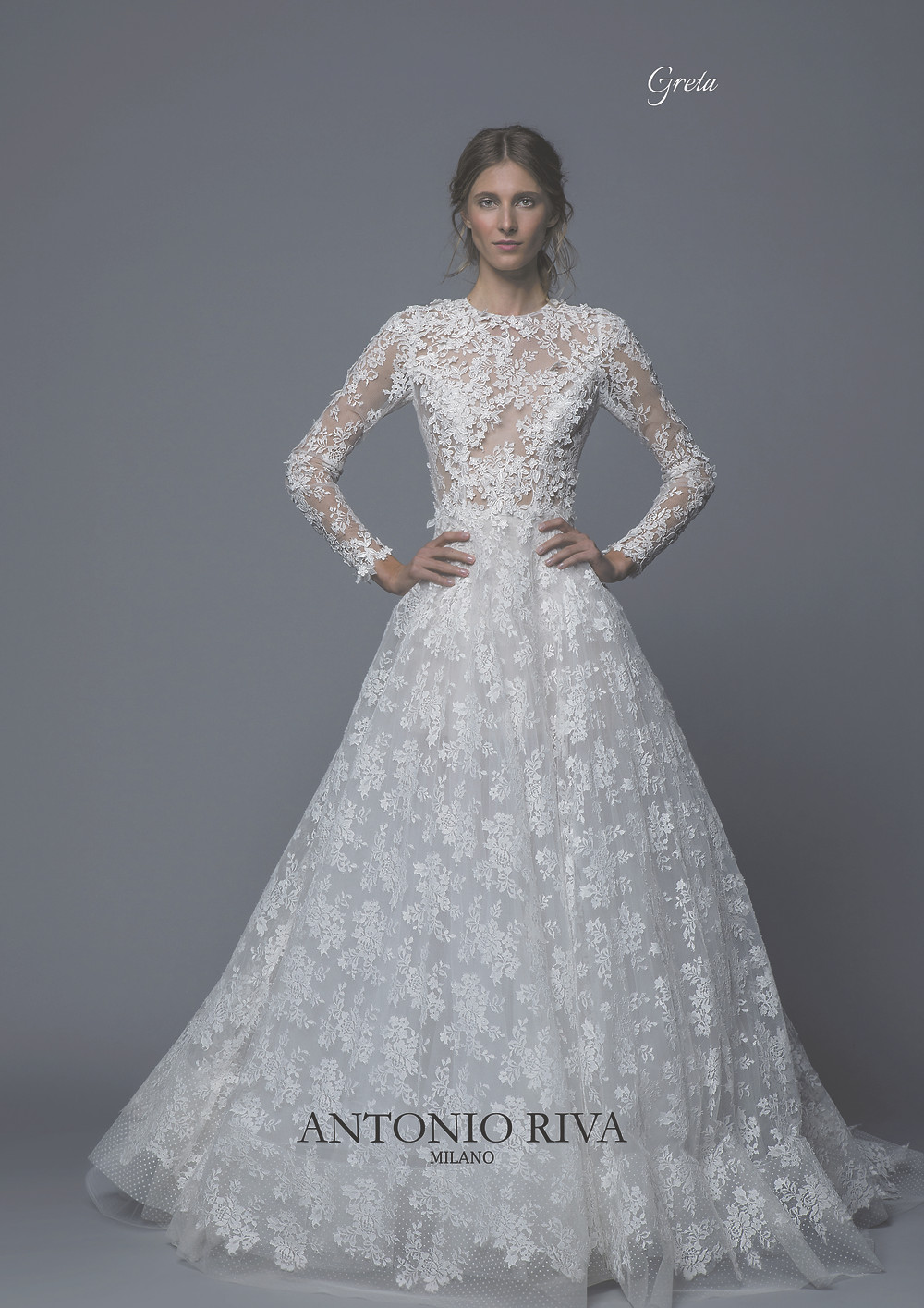 An Antonio Riva 2020 lace ball gown wedding dress with long sleeves and a high neckline