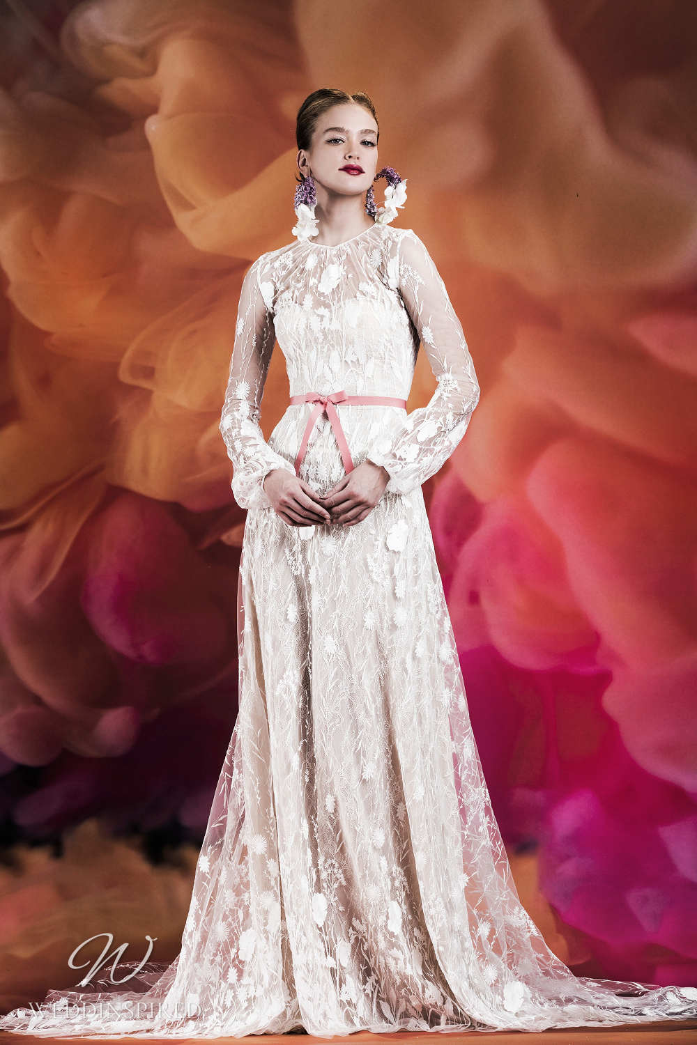 A Naeem Khan lace A-line wedding dress with long sleeves and an illusion neckline