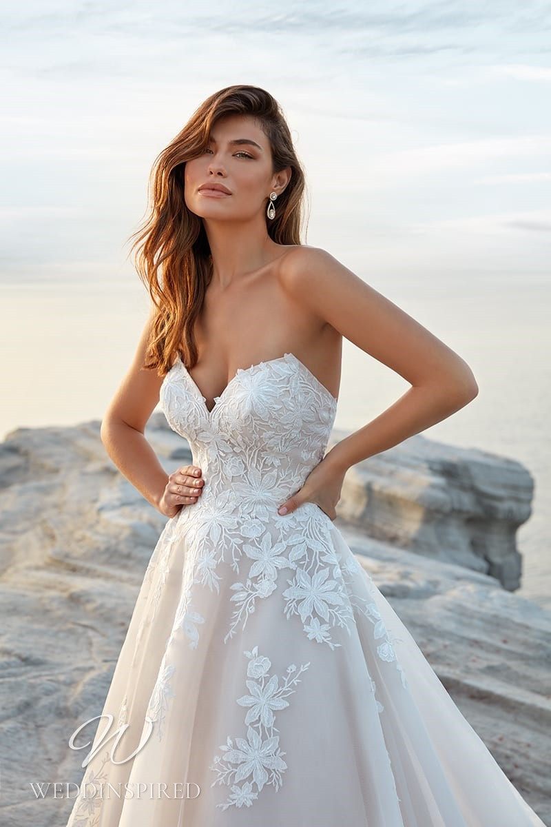 An Eddy K 2022 strapless blush lace and tulle A-line wedding dress