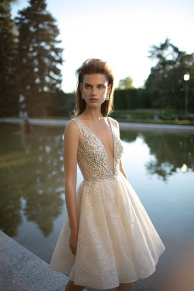 A Berta short ivory tulle wedding dress with a v neckline