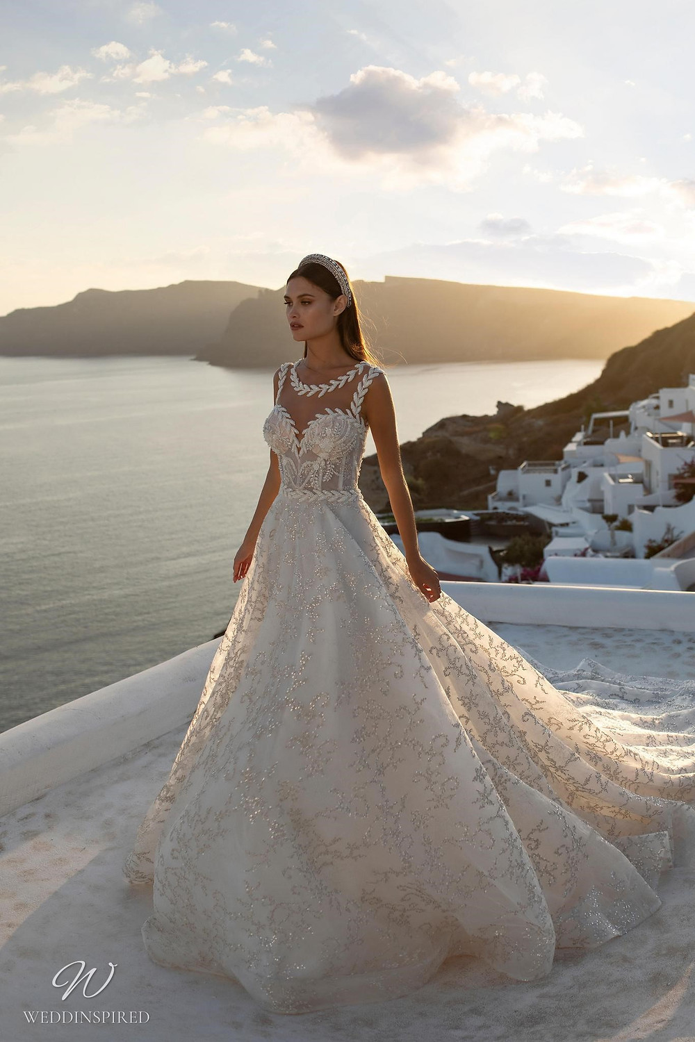 A Ricca Sposa sparkly romantic ball gown wedding dress with a sweetheart neckline and an illusion top