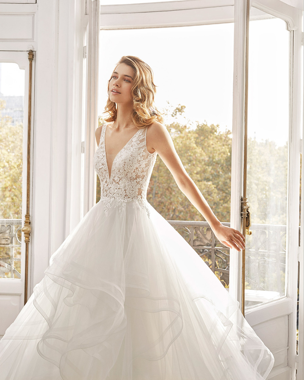 An Aire Barcelona 2020 lace and tulle ball gown wedding dress with a layered ruffle skirt