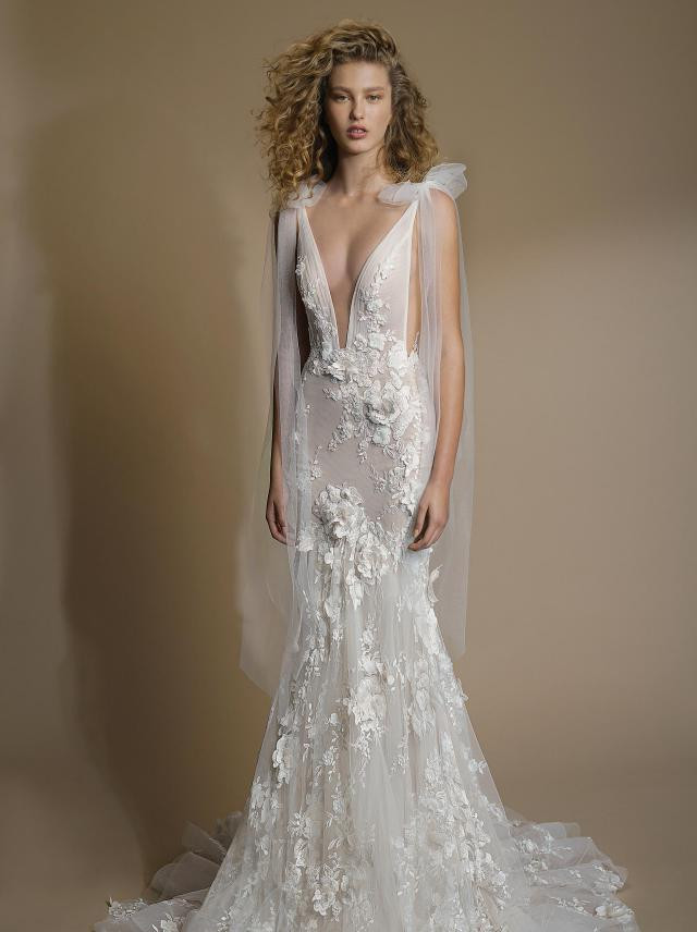 A Galia Lahav lace and mesh mermaid fit and flare wedding dress with a low v neckline and bows