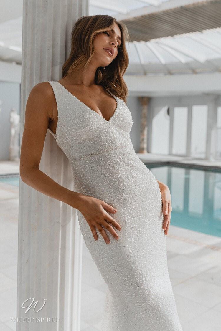 An Anna Campbell 2020 v neck sheath wedding dress with beading