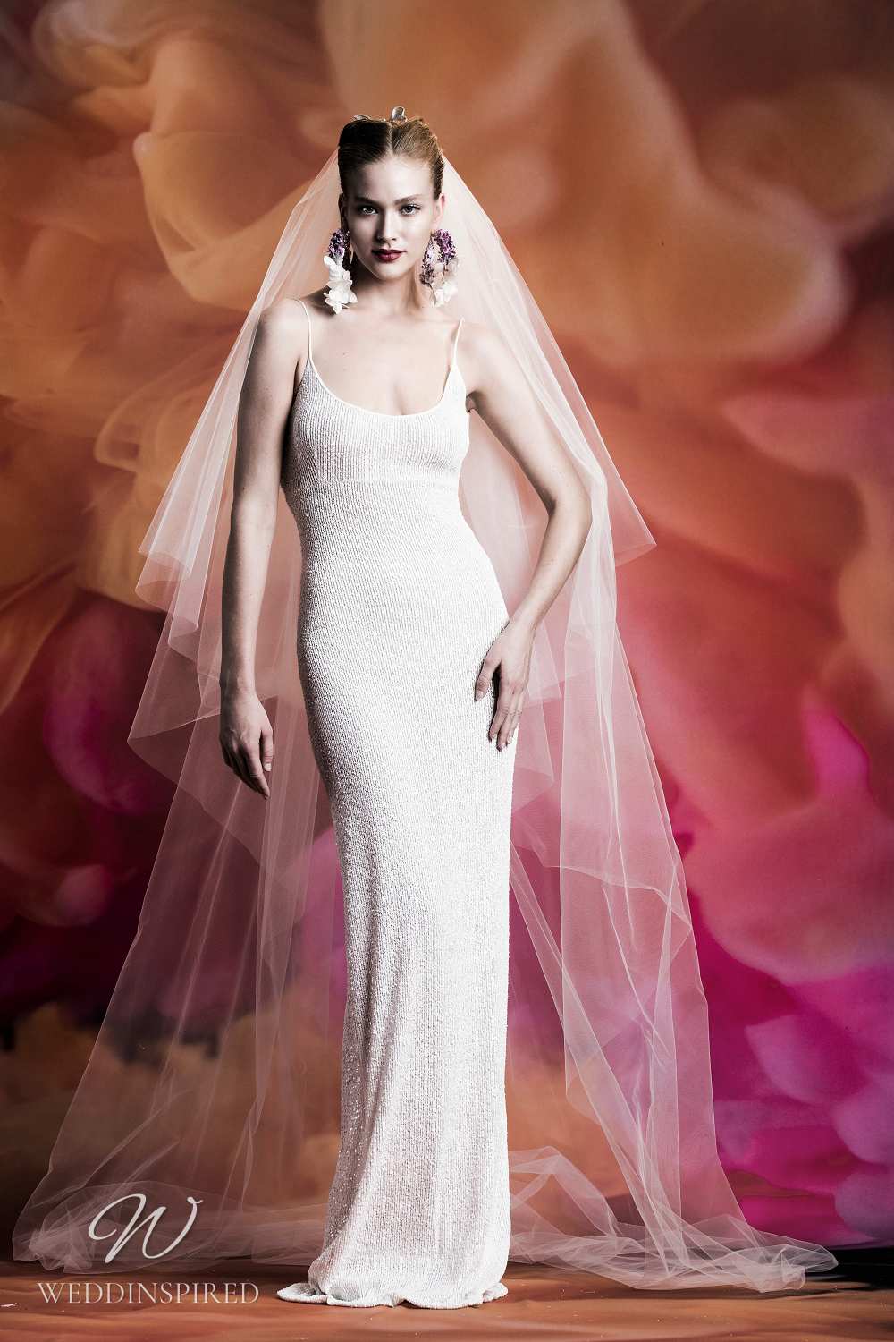 A Naeem Khan fitted column wedding dress with thin straps