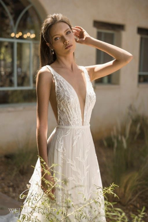 A David Hasbani ivory lace and tulle A-line wedding dress