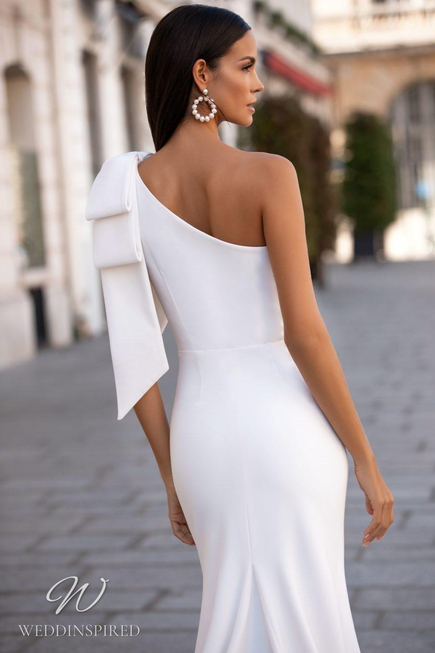 A Milla Nova one shoulder mermaid wedding dress with a bow