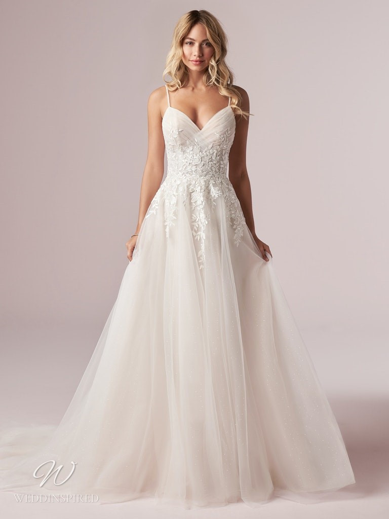 A Rebecca Ingram 2020 blush lace and tulle A-line wedding dress