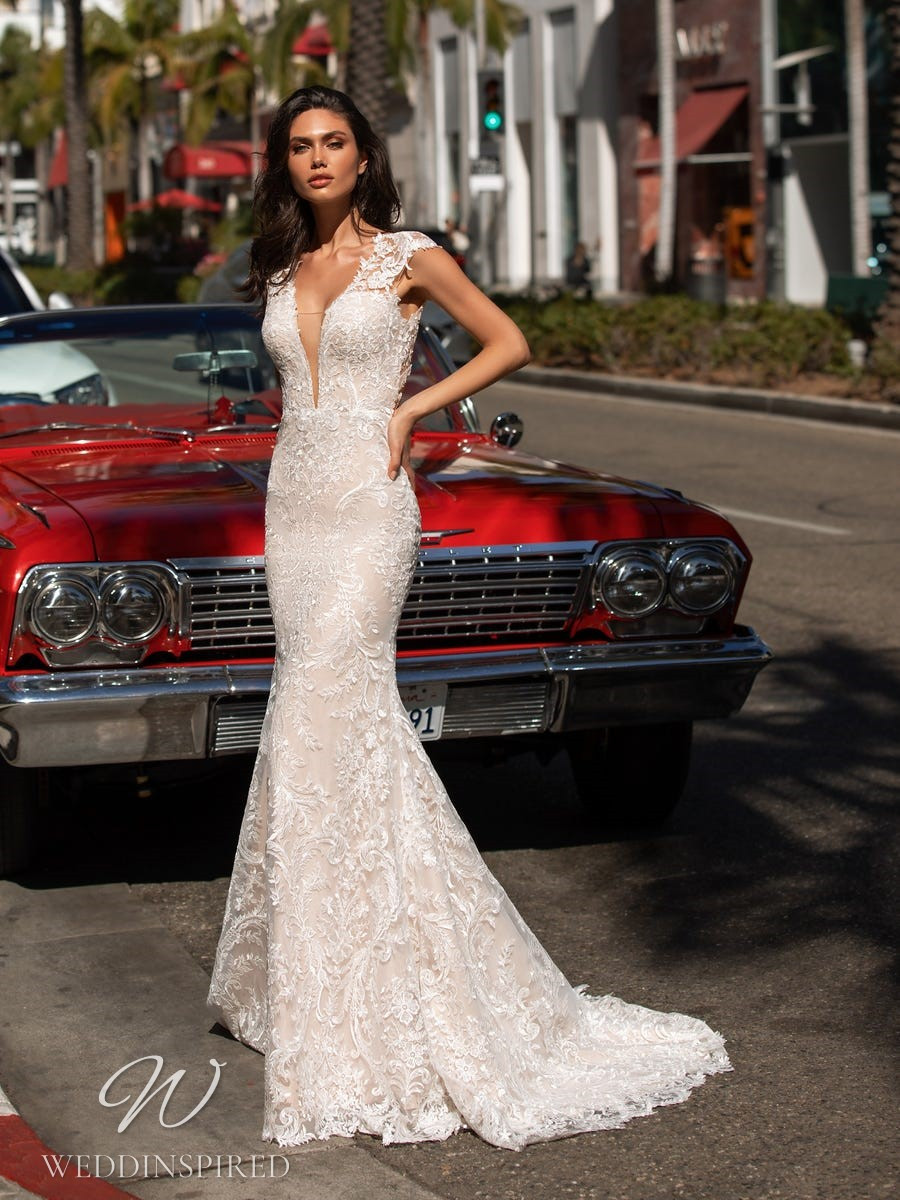 A Pronovias 2021 lace mermaid wedding dress with cap sleeves and a v neck