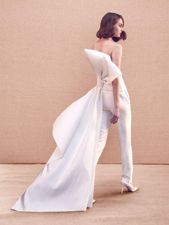 A Oscar de la Renta strapless wedding jumpsuit or pantsuit with a large bow
