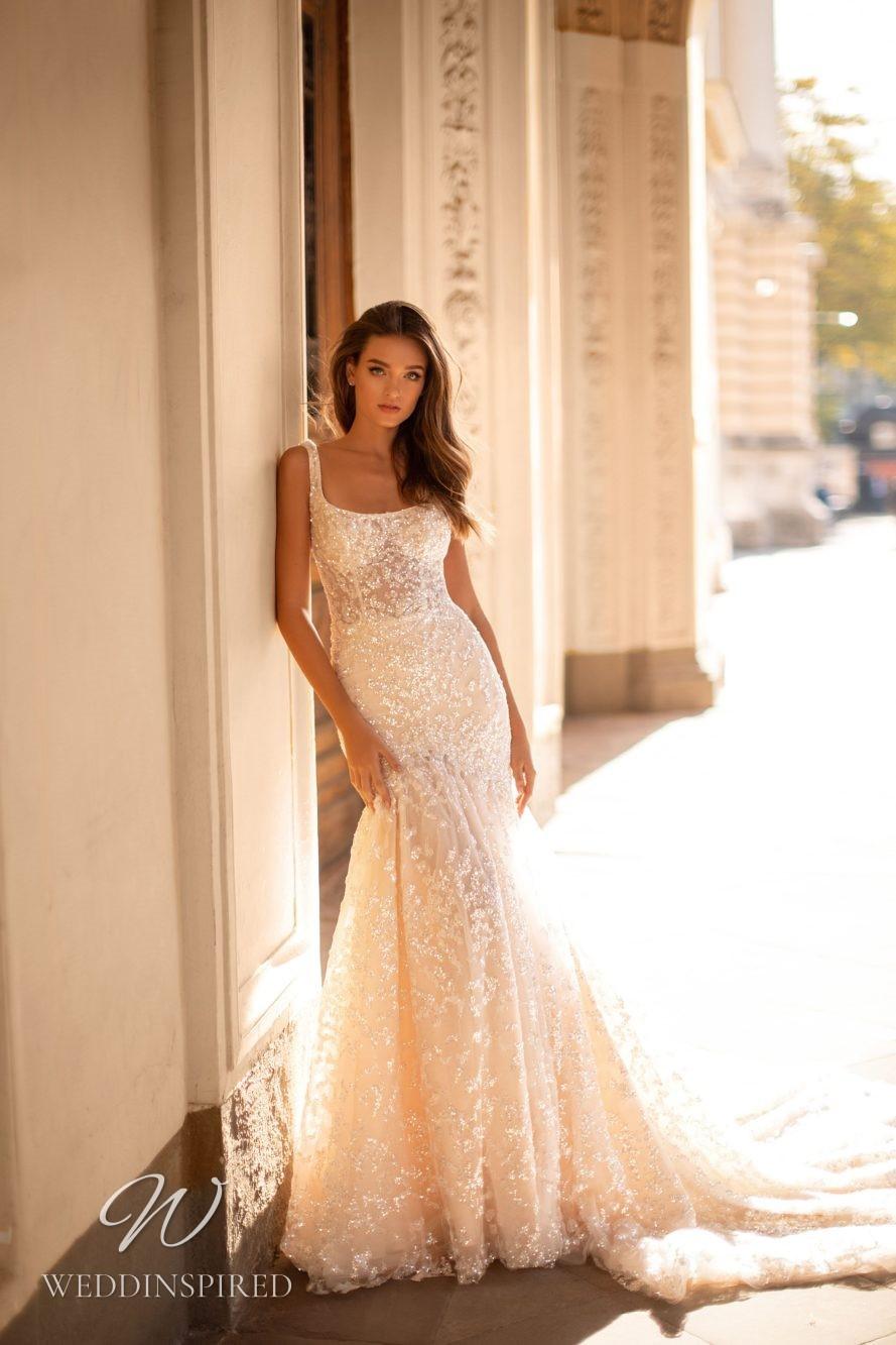 A Milla Nova blush mermaid wedding dress with beading and crystals