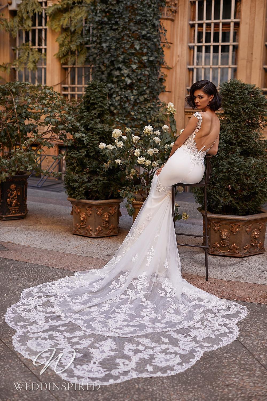 A Daria Karlozi 2021 backless lace and satin mermaid wedding dress