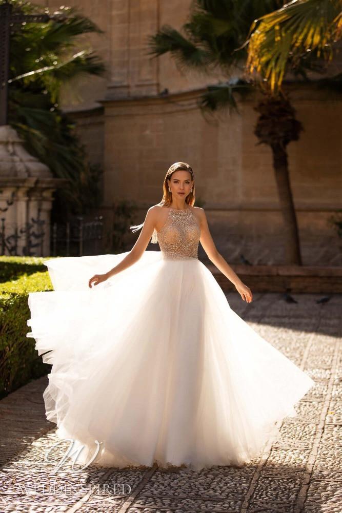 A Nora Naviano 2021 halterneck tulle A-line wedding dress
