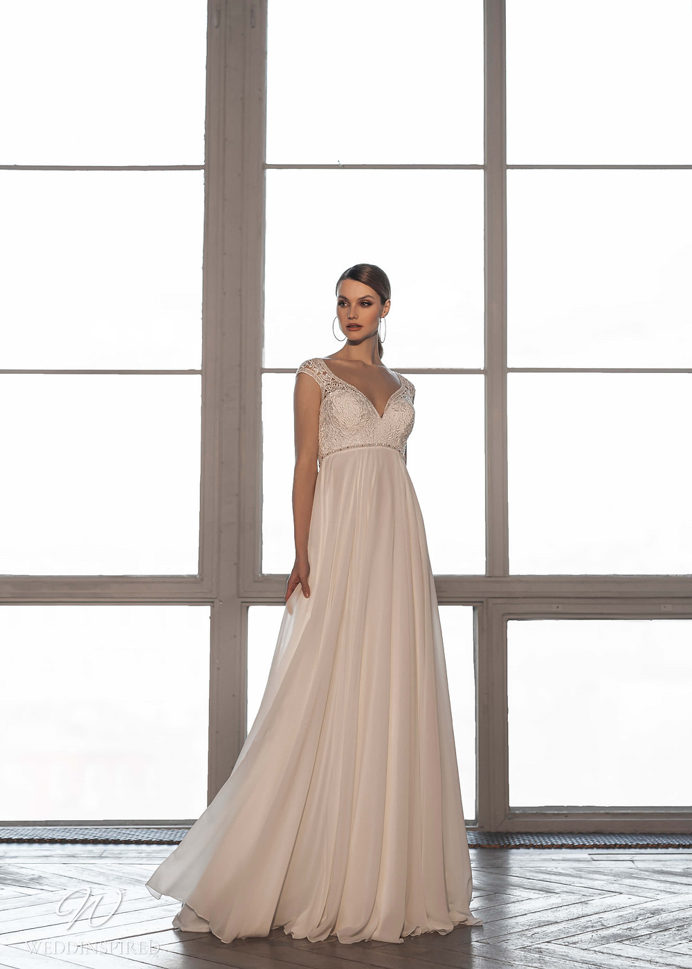 A Naviblue Bridal 2021 blush lace and chiffon romantic empire waist wedding dress