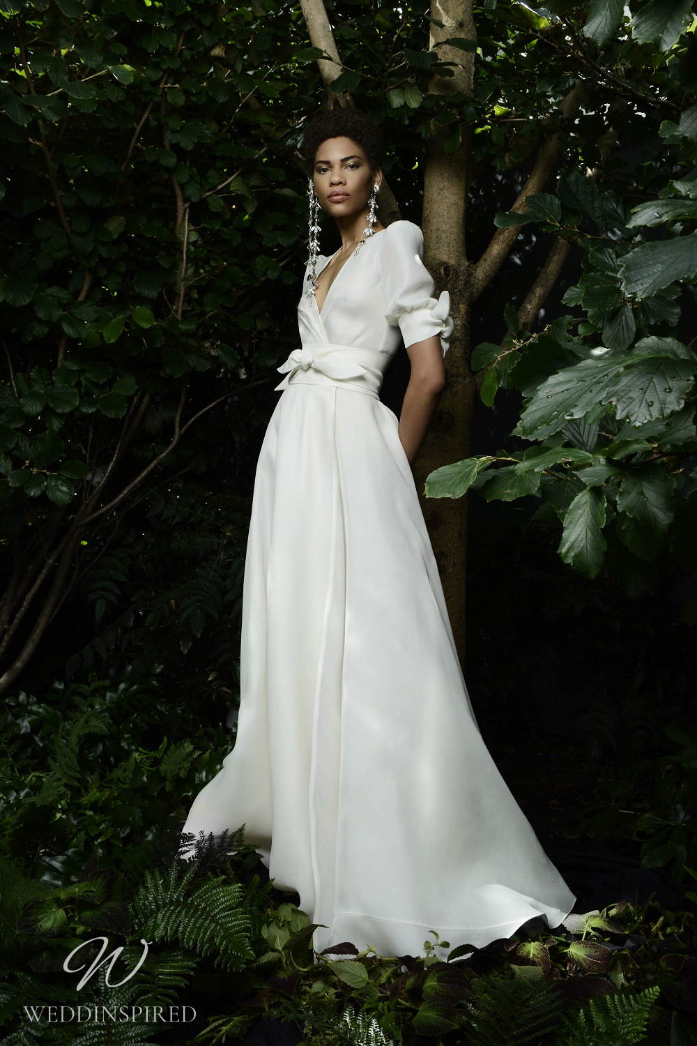A Naeem Khan Fall 2021 simple A-line wedding dress with a v neck and balloon sleeves