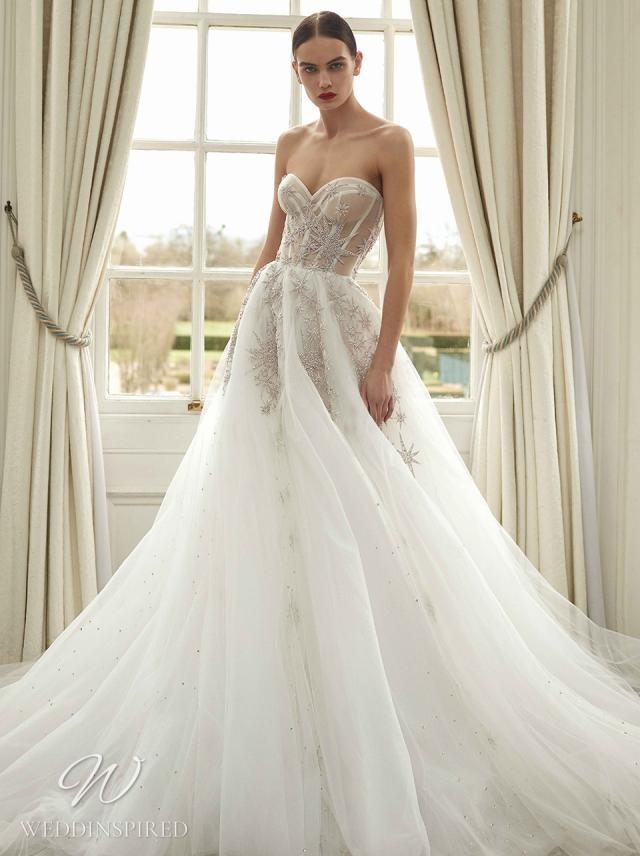 A Galia Lahav 2021 white strapless tulle ball gown wedding dress with glitter star details