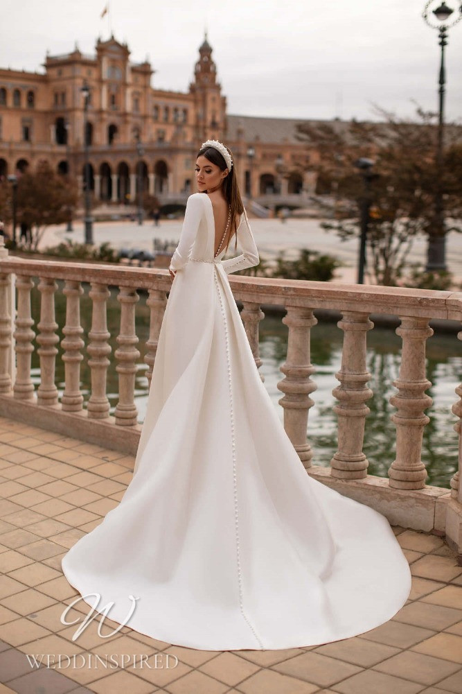A Nora Naviano 2021 backless satin A-line wedding dress with long sleeves
