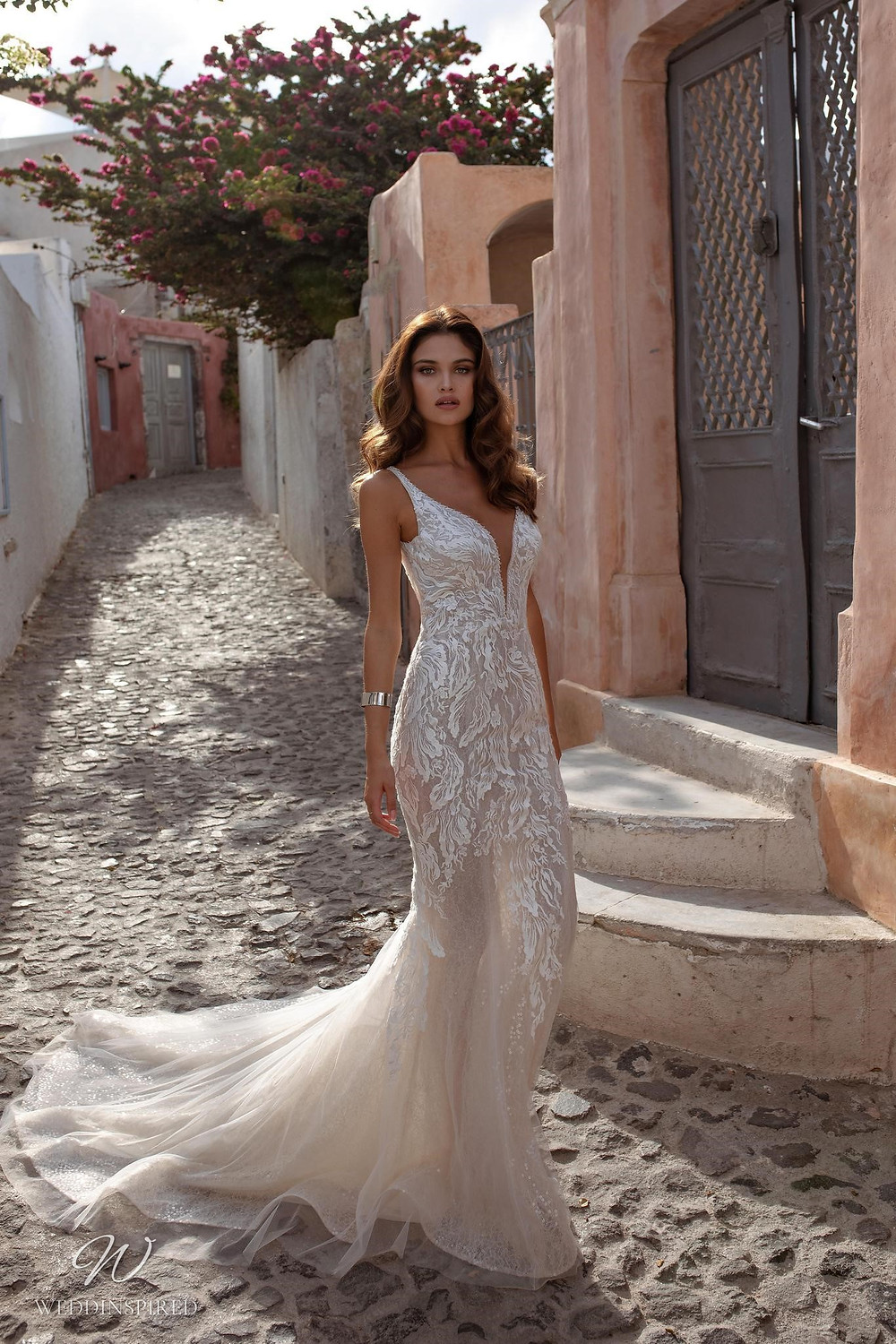 A Ricca Sposa lace and tulle mermaid wedding dress with straps and a v neckline