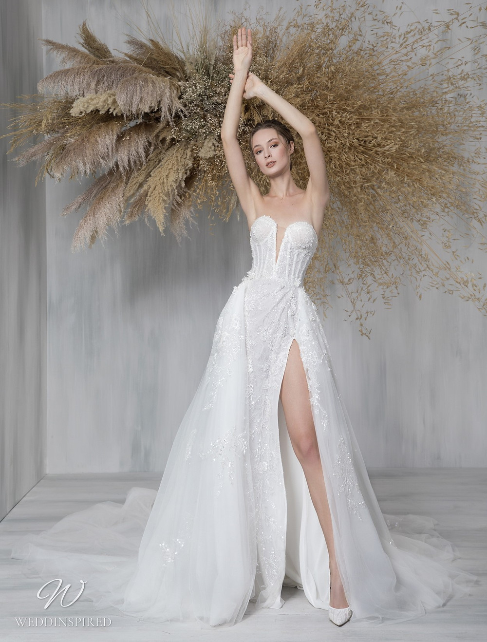 A Tony Ward 2021 strapless lace and tulle ball gown wedding dress with a slit and a v neckline
