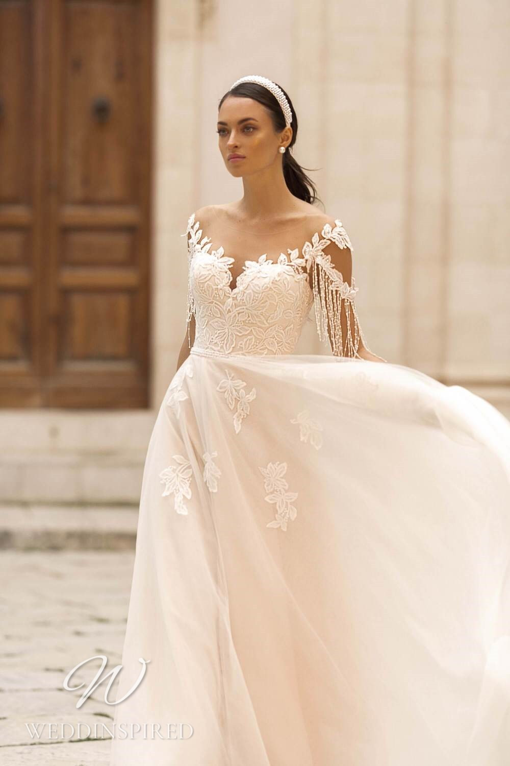 A Lussano 2021 off the shoulder blush lace and tulle A-line wedding dress