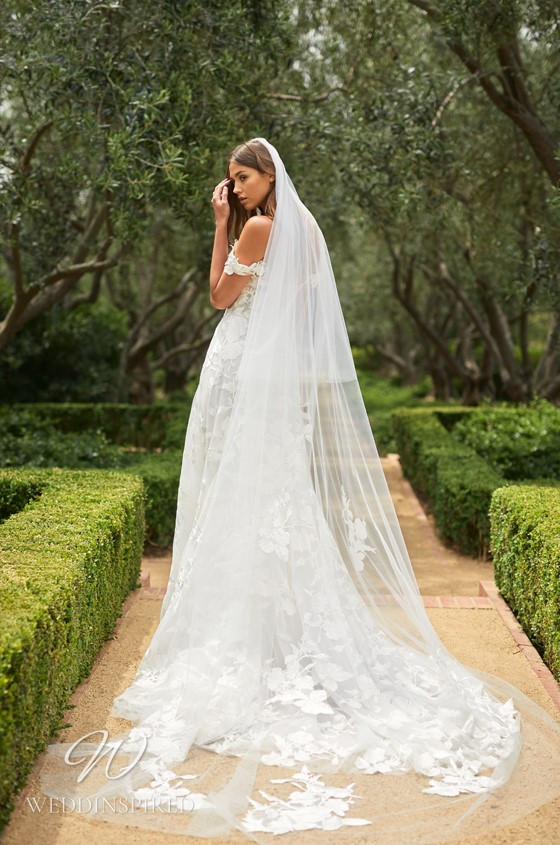 A Monique Lhuillier lace off the shoulder A-line wedding dress