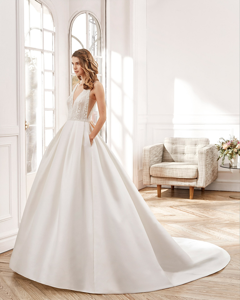An Aire Barcelona 2020 lace and silk ball gown wedding dress with pockets and a v neckline