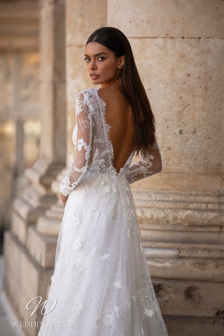 A Milla Nova lace A-line wedding with a low back and long sleeves