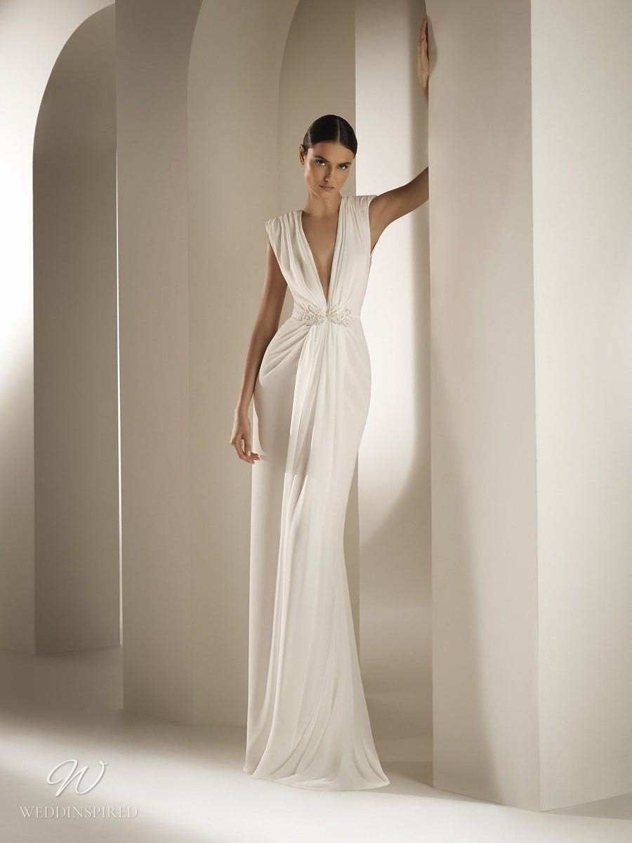 An Atelier Pronovias Grecian style empire waist wedding gown with a low v neckline