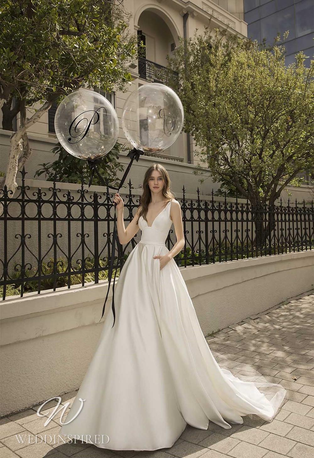 A Pnina Tornai 2021 satin A-line wedding dress with pockets