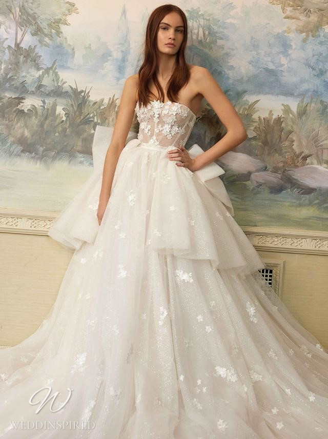 A Galia Lahav 2021 flowy strapless ball gown wedding dress with a layered tulle skirt and bow