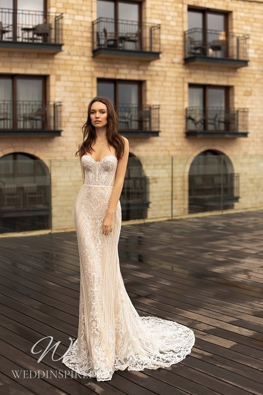 An Ida Torez 2021 blush lace mermaid wedding dress with a sweetheart neckline