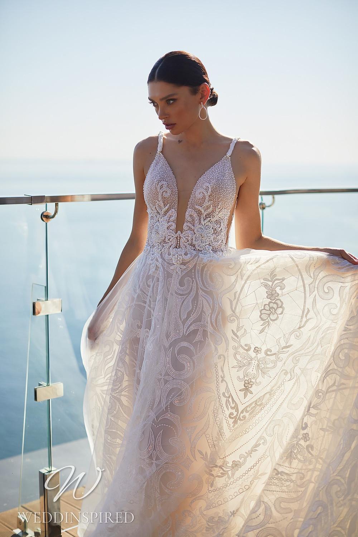 An Ida Torez 2021 blush tulle A-line wedding dress