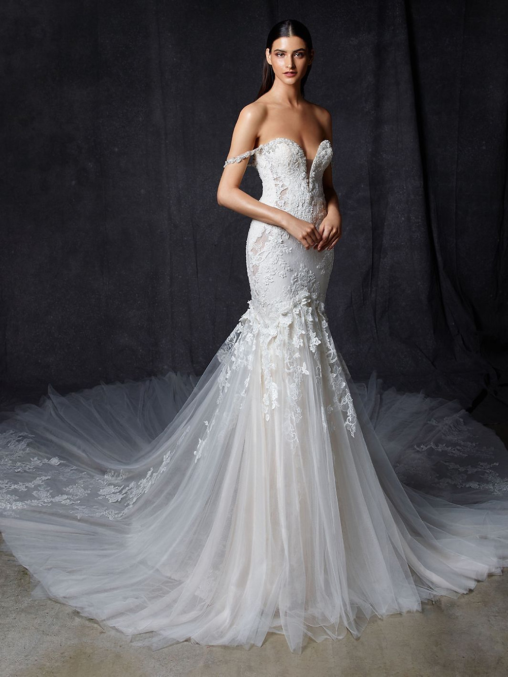 An Enzoani off the shoulder lace mermaid wedding dress with a tulle skirt and a sweetheart neckline