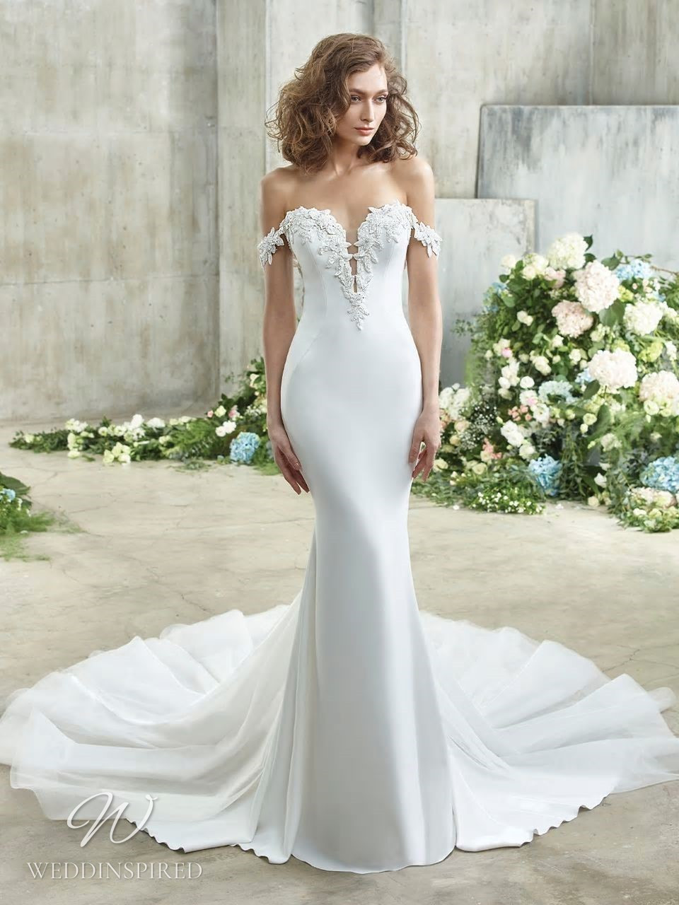 A Badgley Mischka off the shoulder mermaid wedding dress with a train and a sweetheart neckline