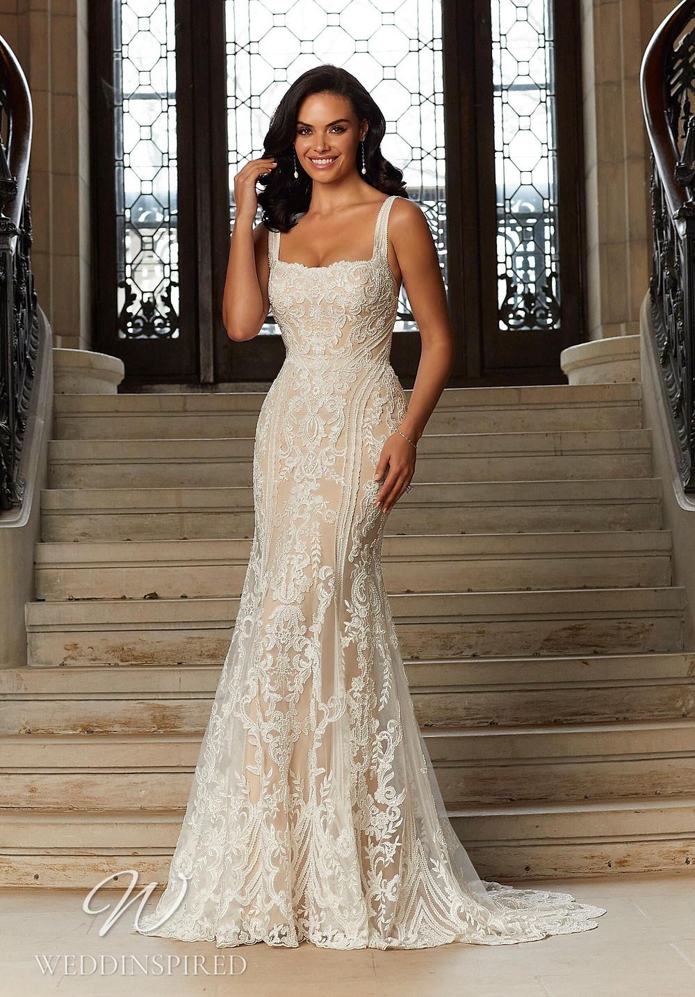 A Madeline Gardner blush lace mermaid wedding dress with straps