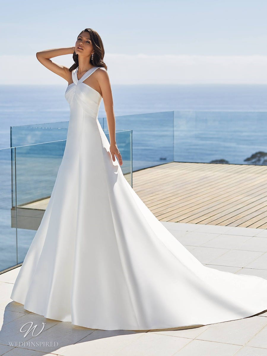 A Pronovias 2021 simple halterneck silk A-line wedding dress