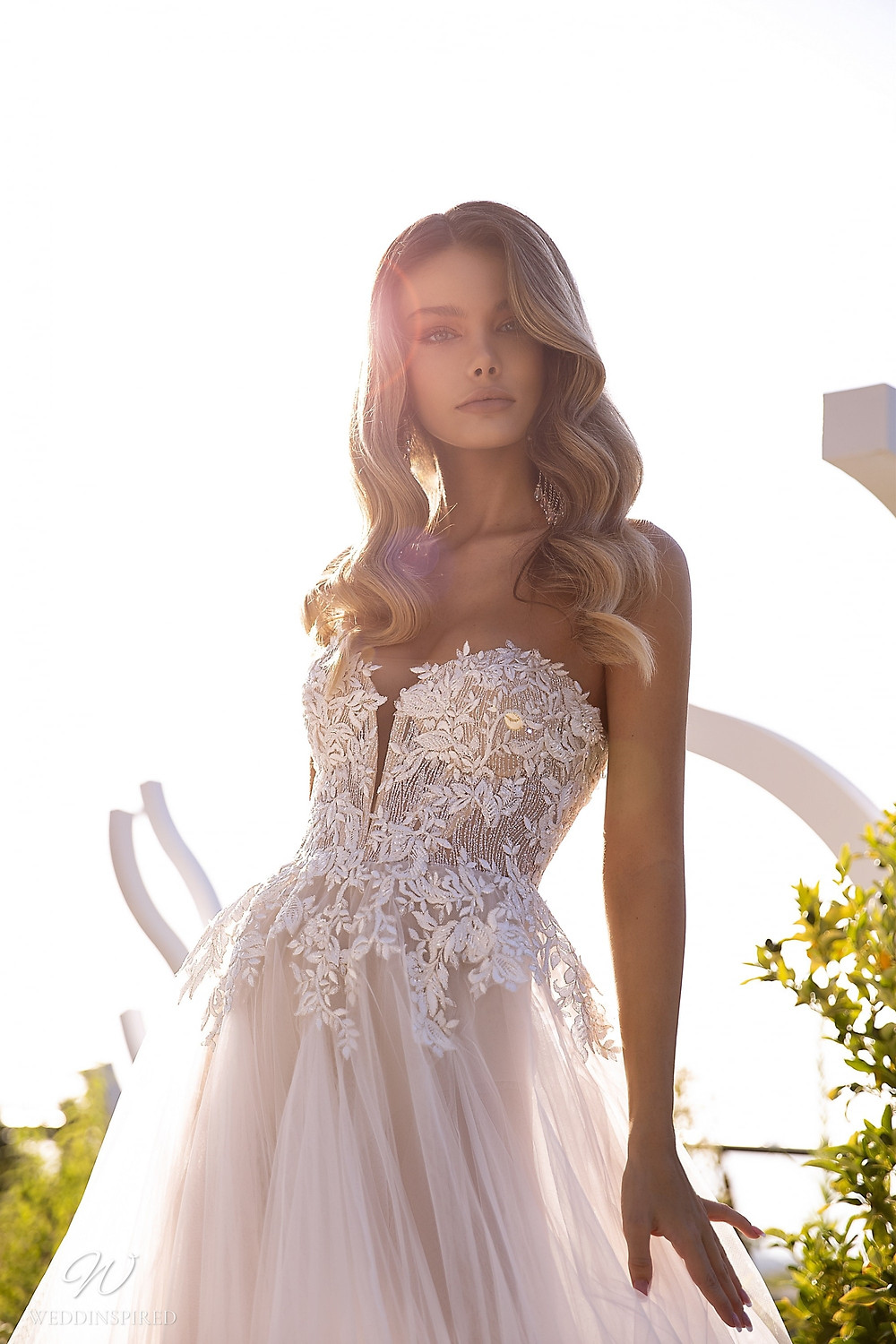 A Tina Valerdi sparkly blush strapless A-line wedding dress with a lace bodice and sweetheart neckline