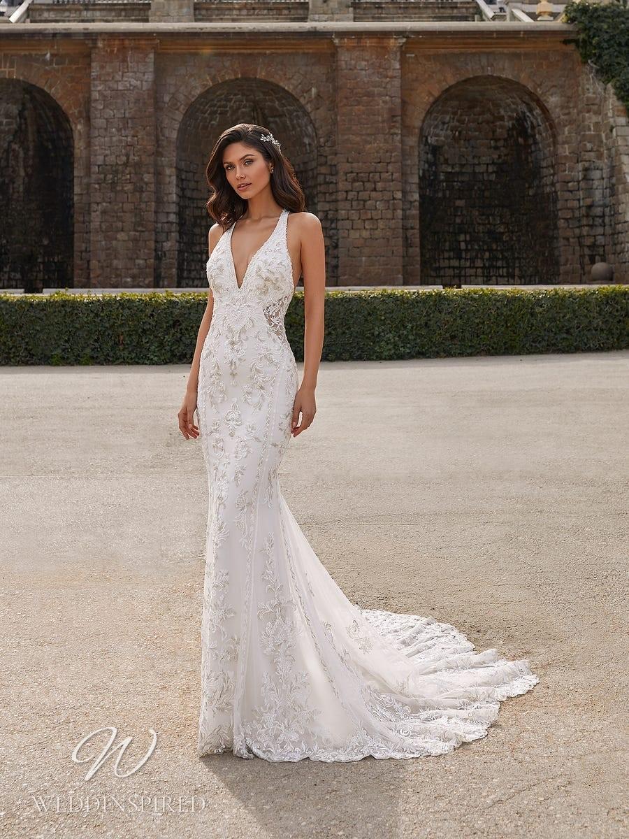 A Pronovias Privée 2021 lace halterneck mermaid wedding dress with a v neck