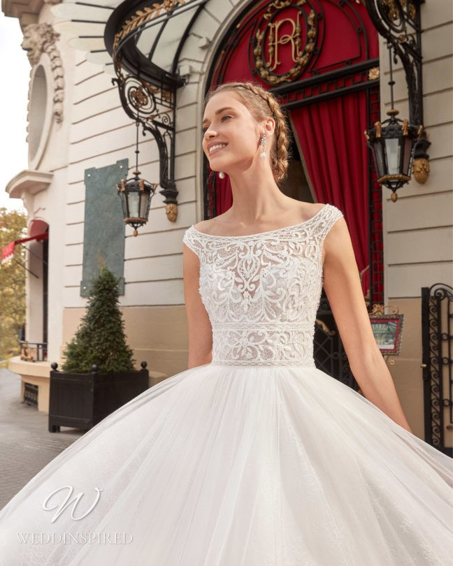 An Aire Barcelona 2021 off the shoulder lace and tulle princess wedding dress