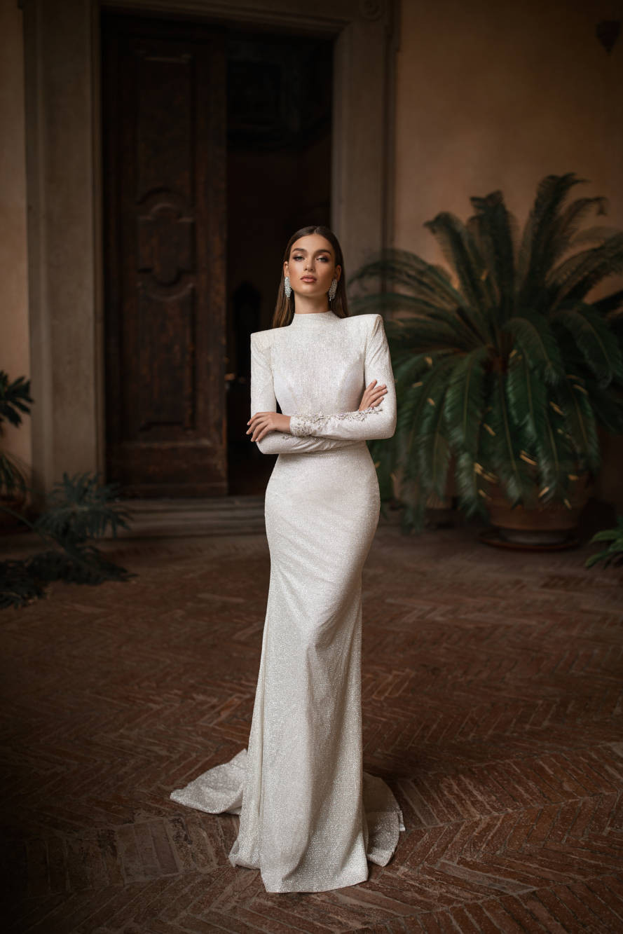 A Milla Nova sparkly modest mermaid wedding dress with long sleeves