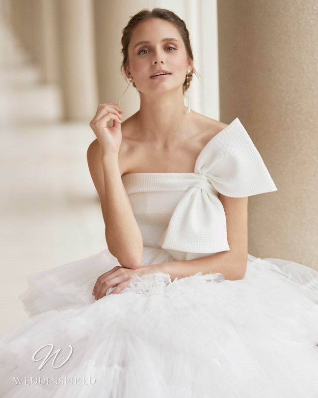 An Aire Barcelona 2021 strapless tulle A-line wedding dress with a bow