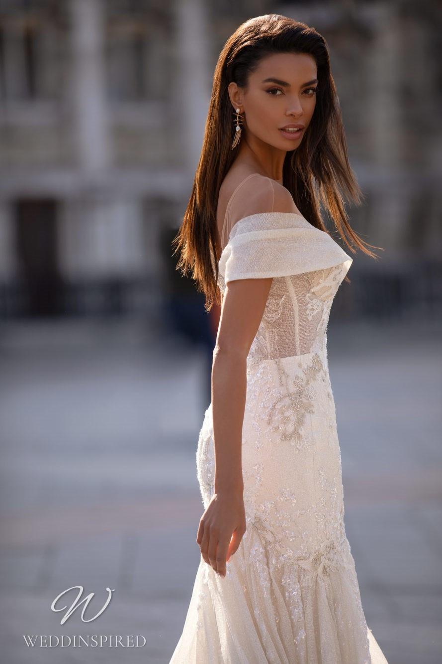 A Milla Nova lace off the shoulder mermaid wedding dress