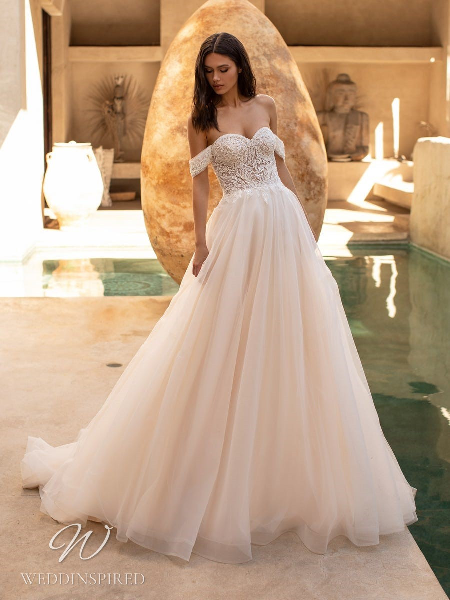 A Pronovias 2021 off the shoulder blush lace and tulle A-line wedding dress