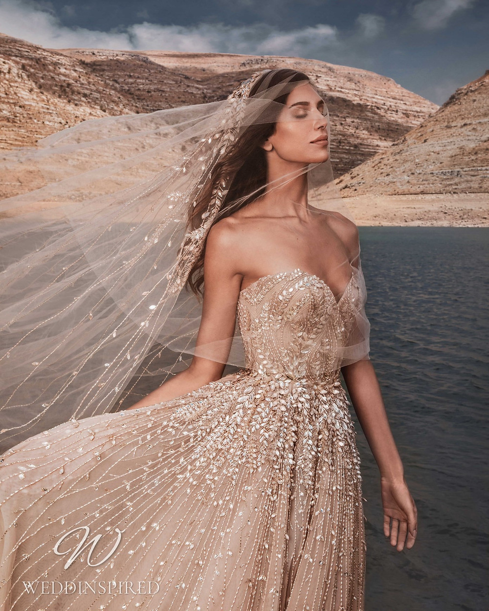 A Zuhair Murad Fall 2021 blush sparkly strapless A-line wedding dress with a sweetheart neckline