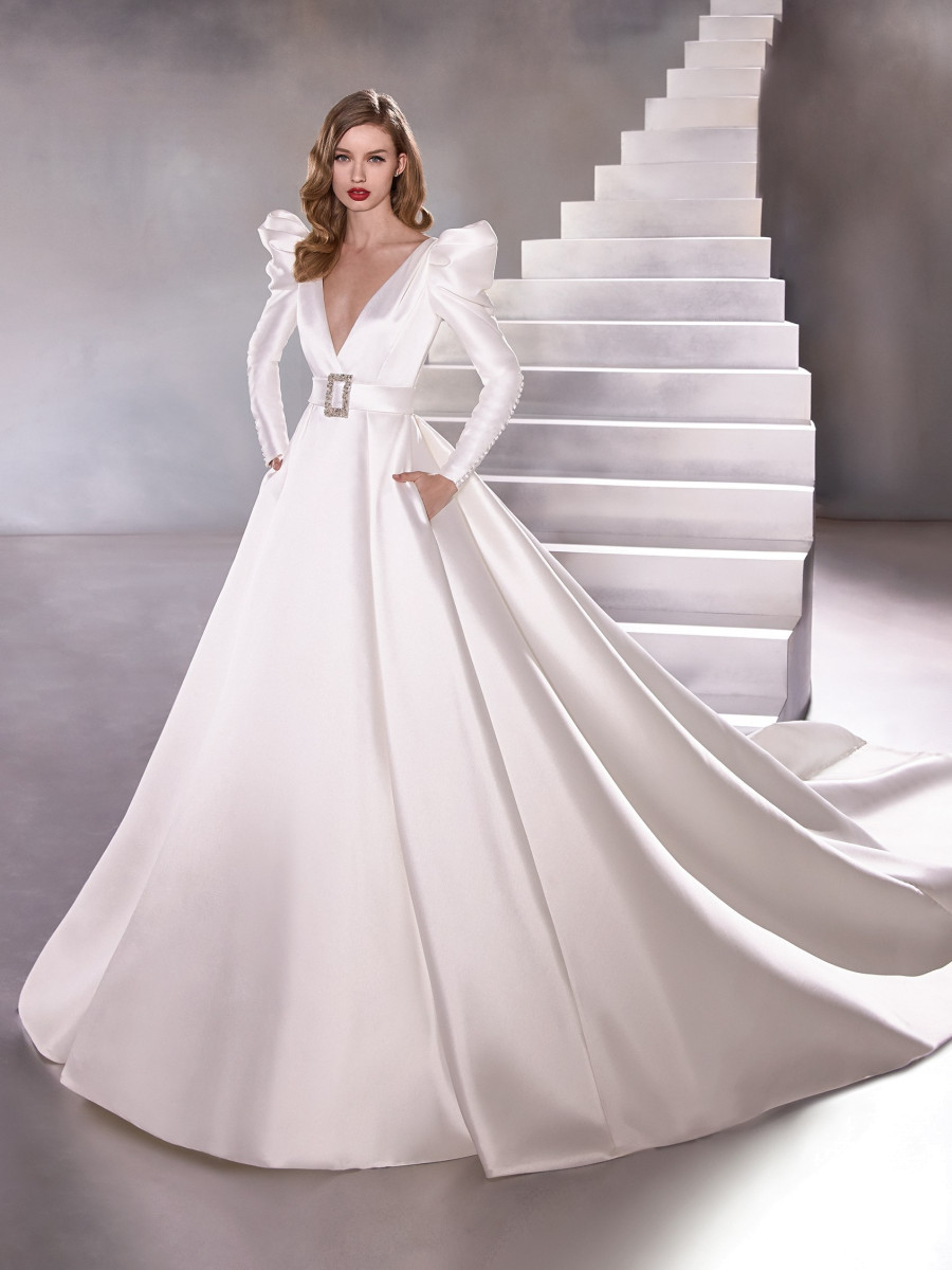 A Pronovias silk ball gown wedding dress with pockets and long balloon puff sleeves