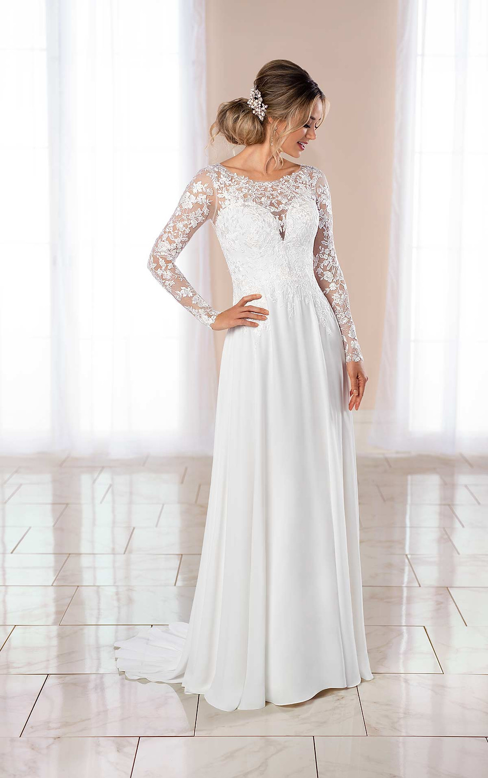 A Stella York 2020 lace and chiffon empire waist wedding dress with long sleeves
