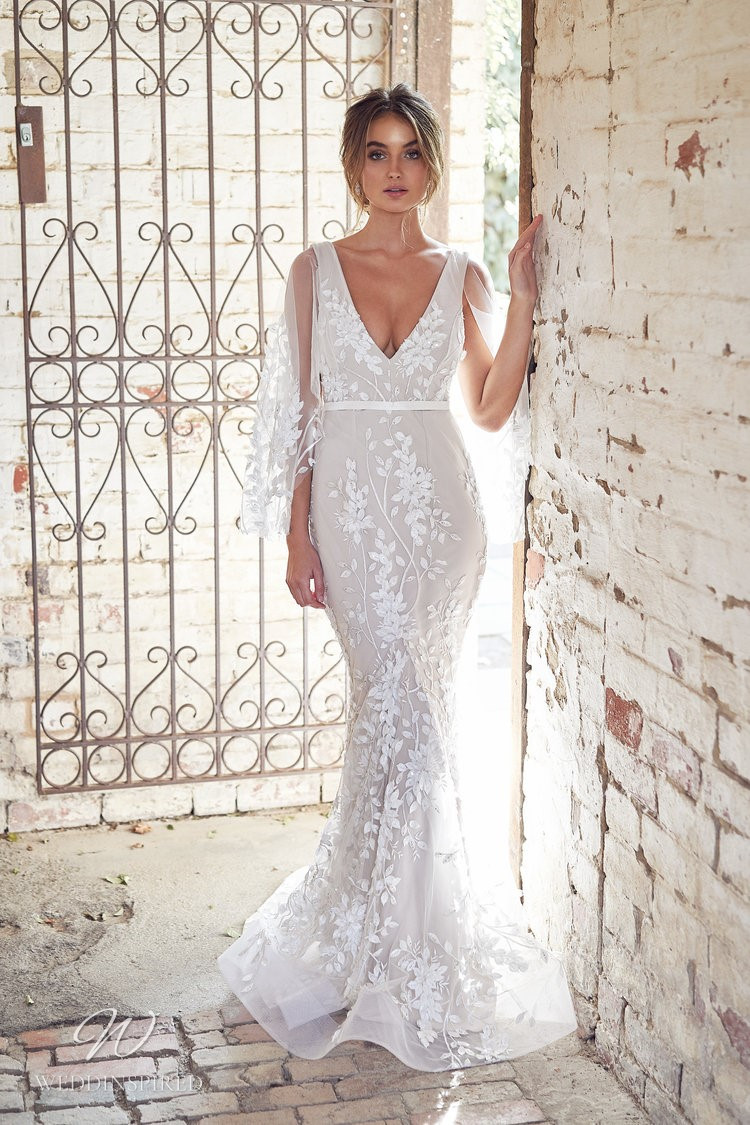 An Anna Campbell 2020 trumpet wedding dress with draped sleeves, tulle and lace