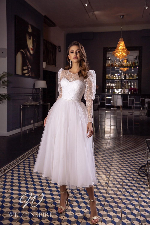 A Tina Valerdi tulle and lace tea length wedding dress